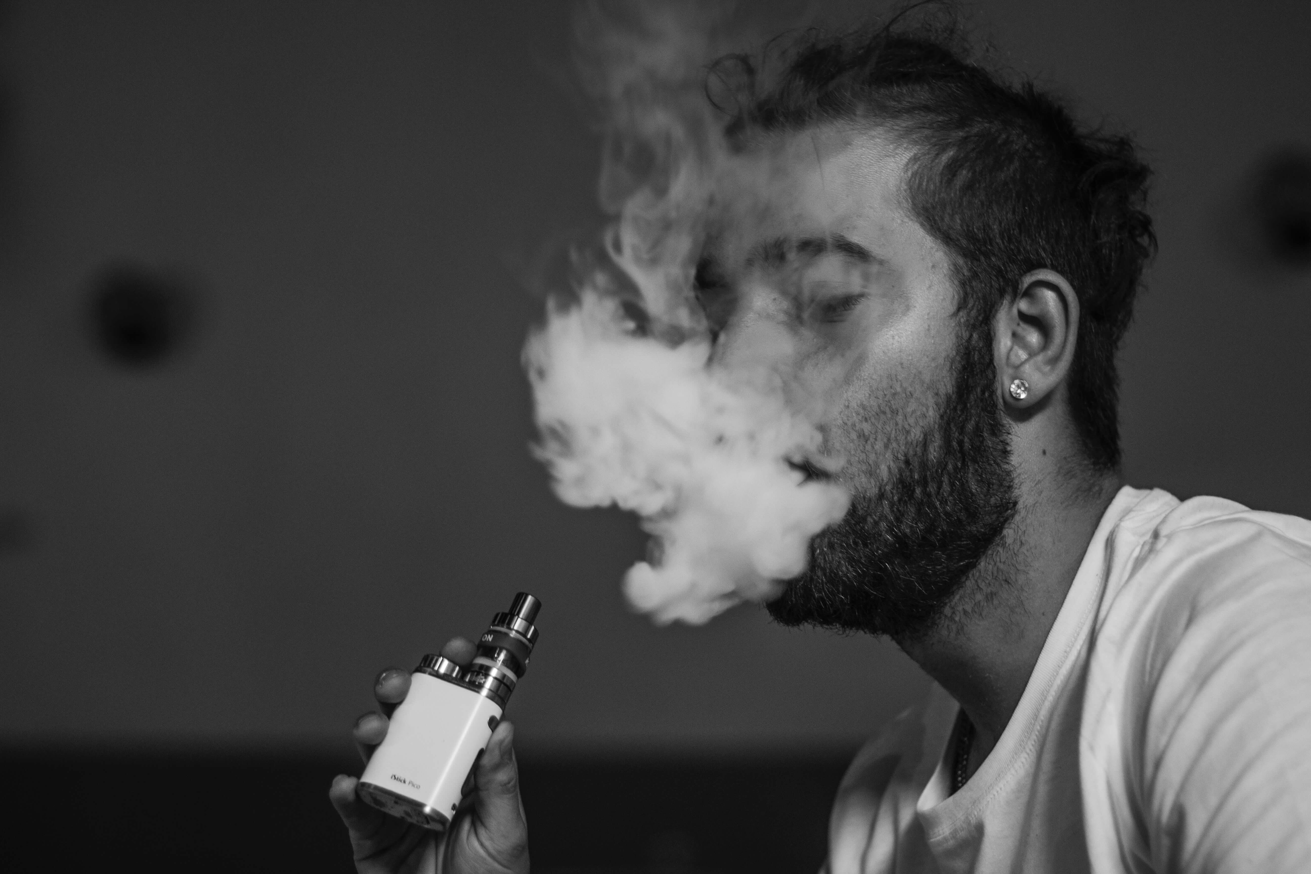 guy smoking from e-cigarette